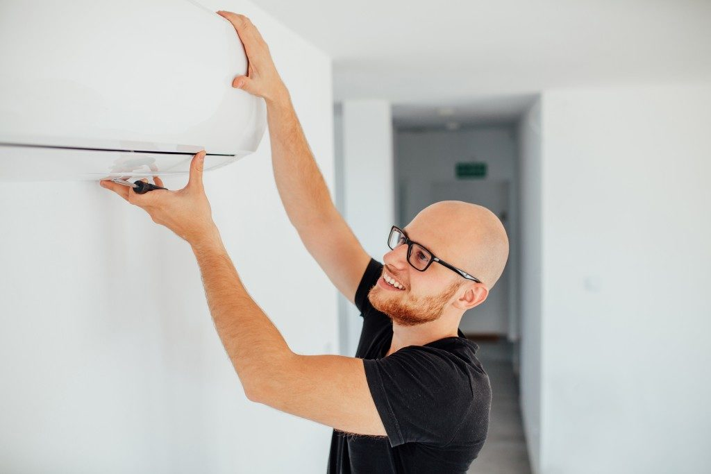 Man checking air conditioning