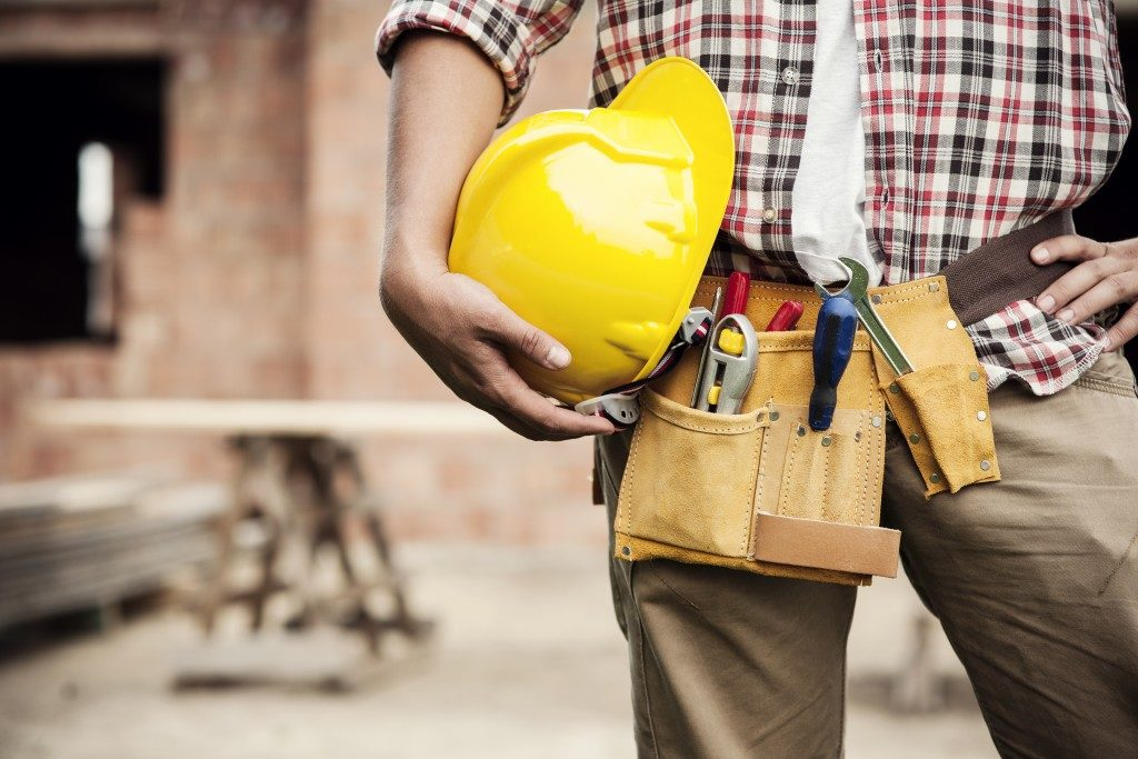 Construction worker holding his hard hat