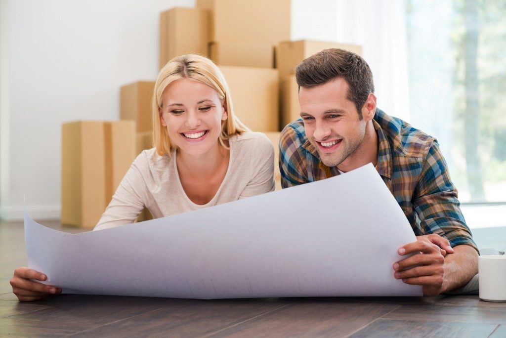 Couple looking at plan new house