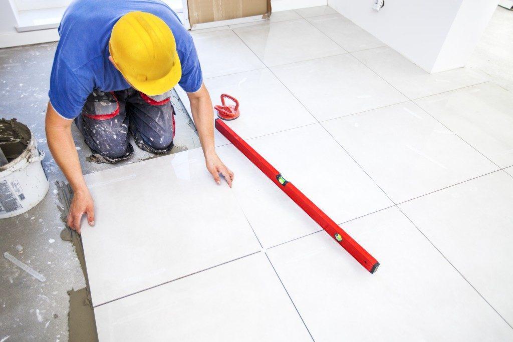 Construction worker tiling