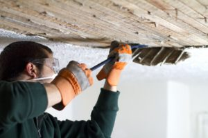 Man fixing his ceiling to install extra storage
