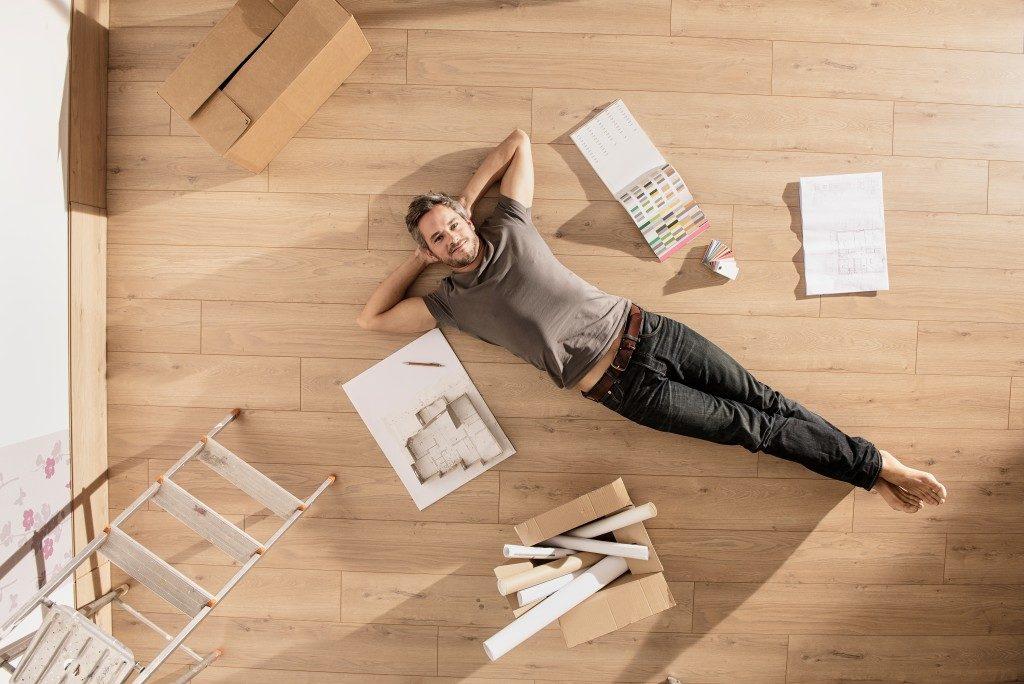 Man lying on the floor new house
