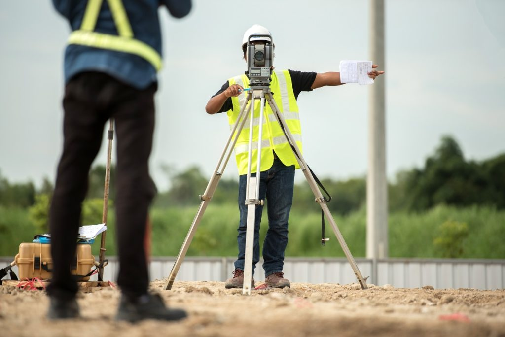 land surveyor giving hand signals