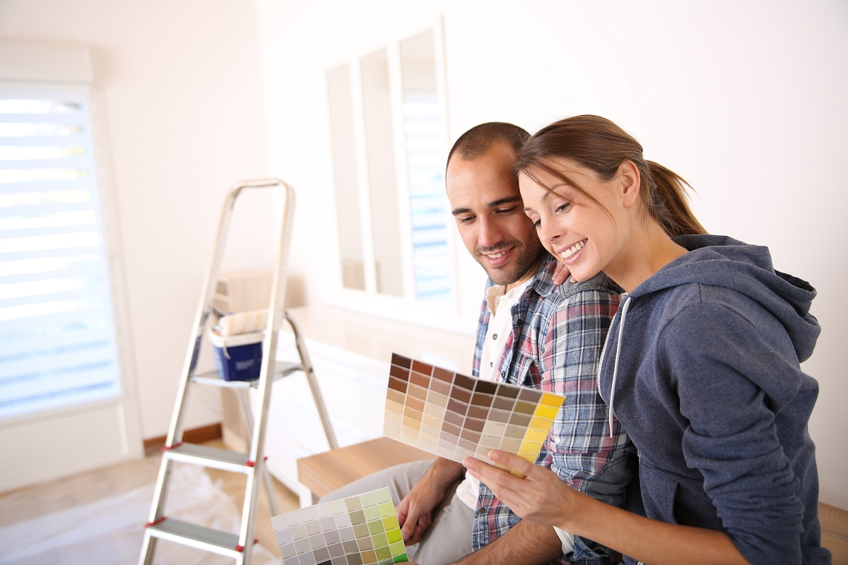 Couple choosing a new wall color