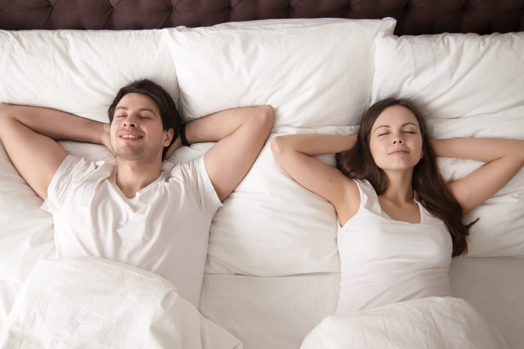 Couple relaxing on the mattress
