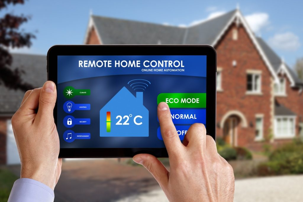 Man holding a smart home controller