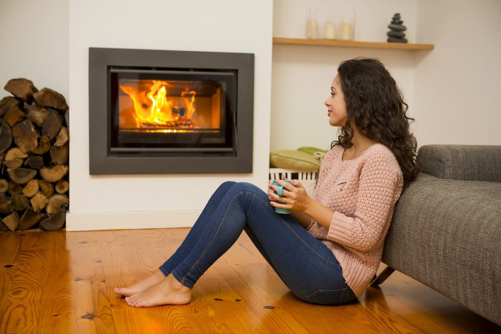 Woman hanging out near the fireplace