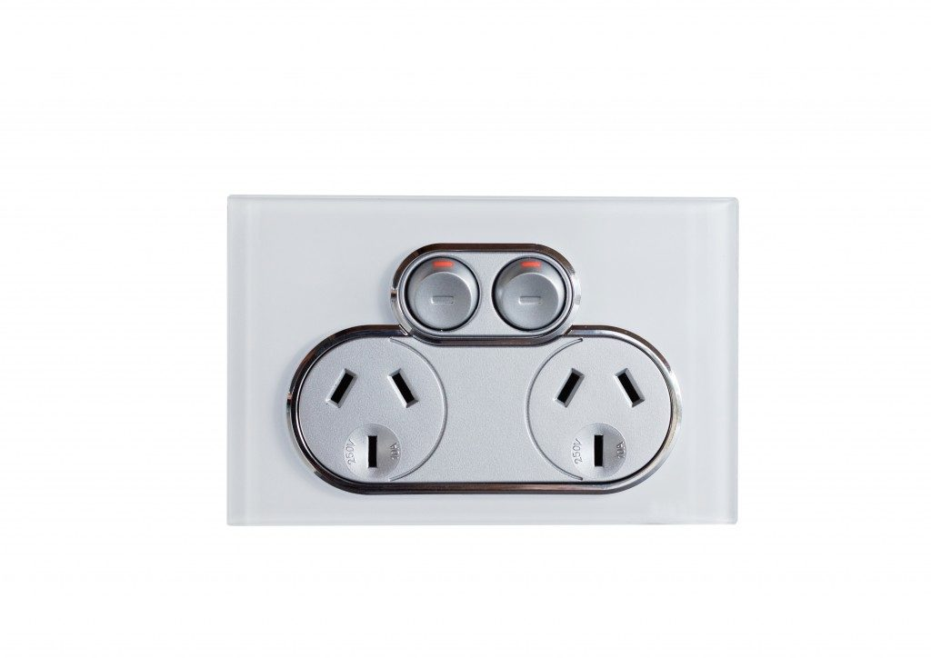 Electric outlet in white background