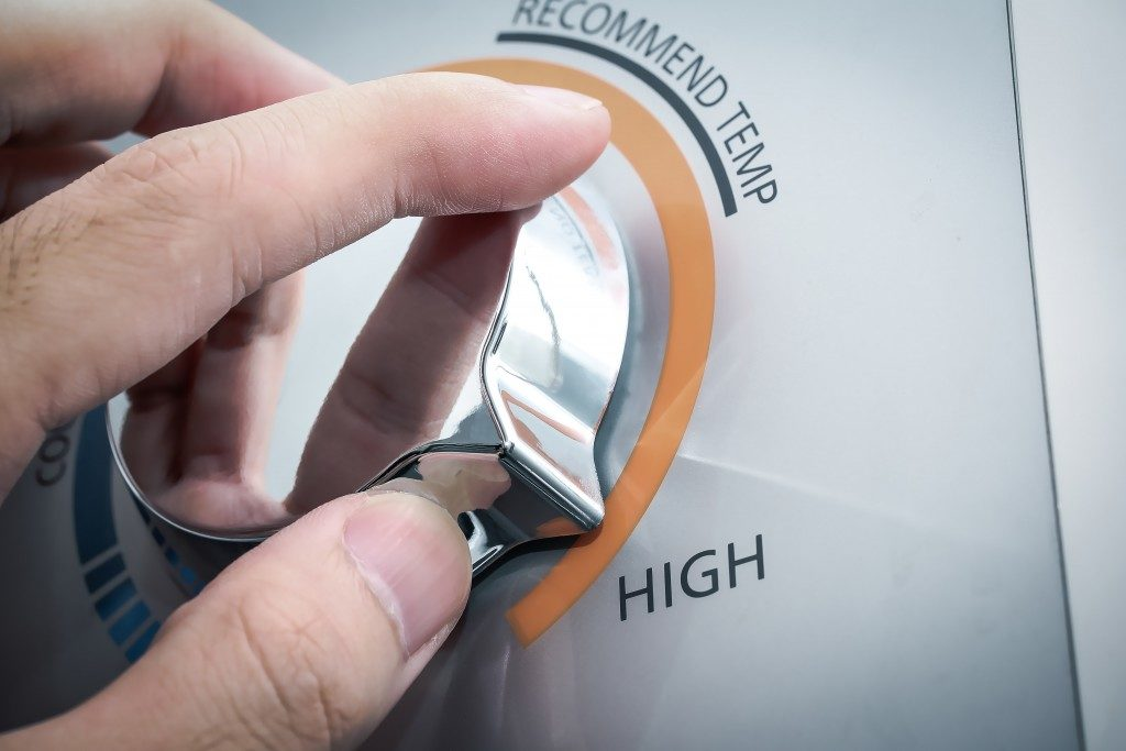 hand adjusting temperature