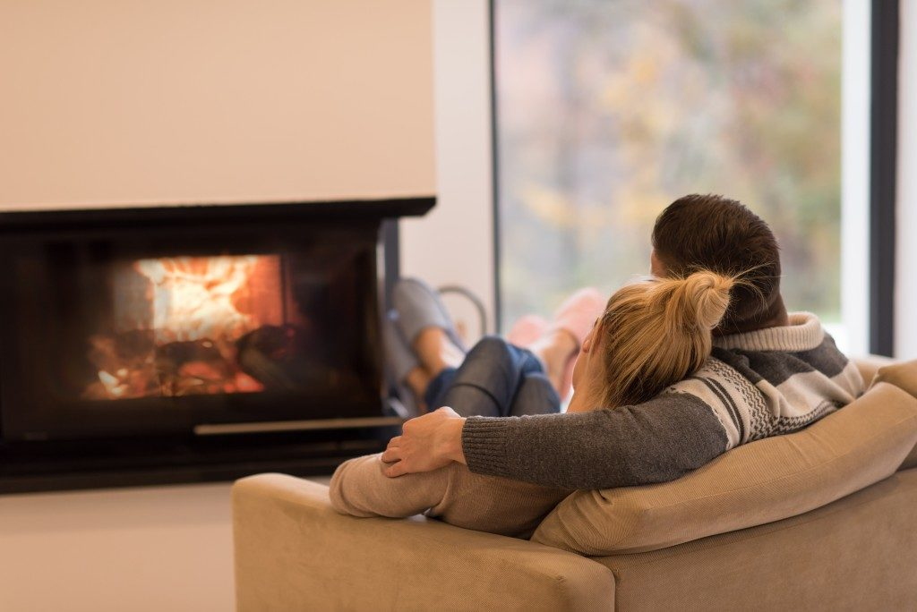 Couple hanging out near the fireplace