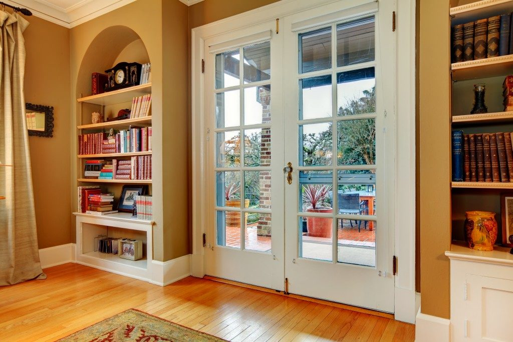 Front door with book shelves on both sides