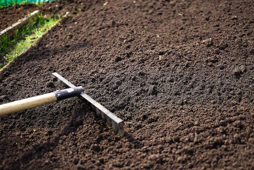 Top soil being raked