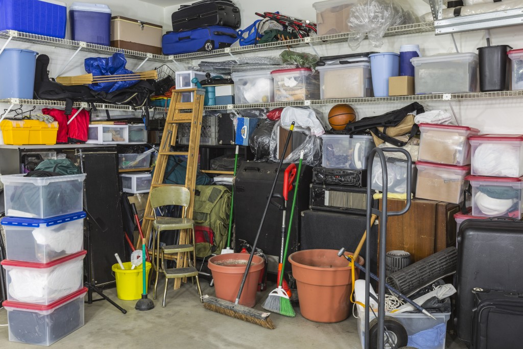 Residential garage full of junk and storage