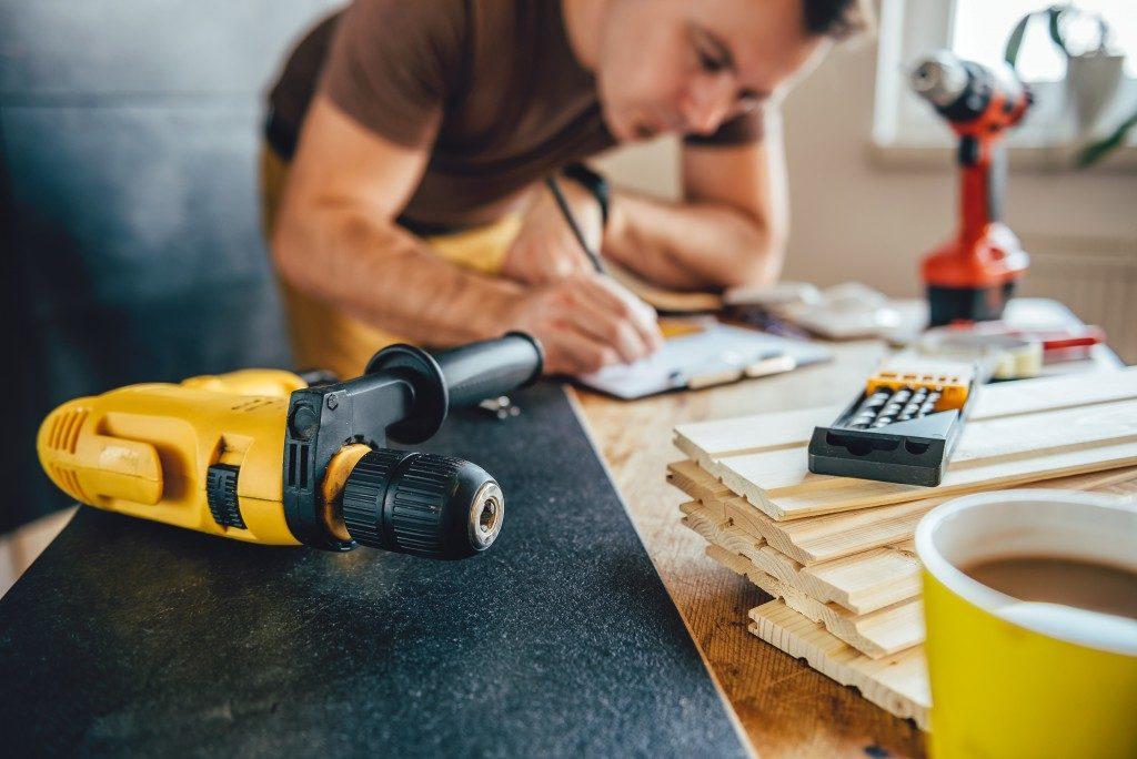man planning home renovation