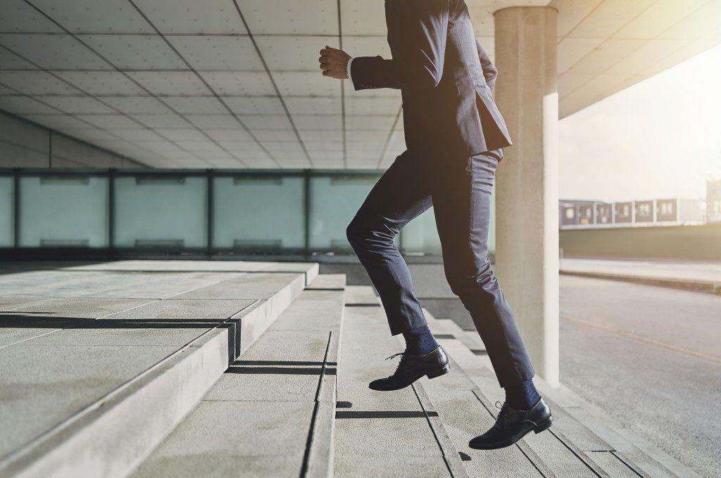 man climbing a stair