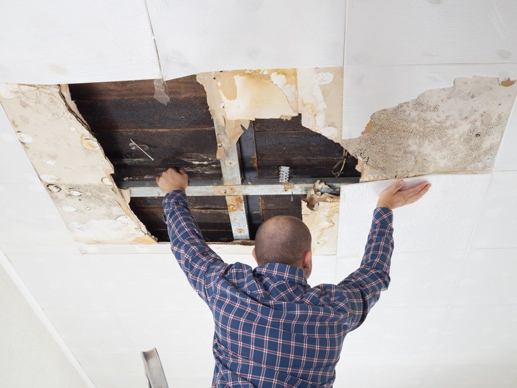 man fixing his ceiling