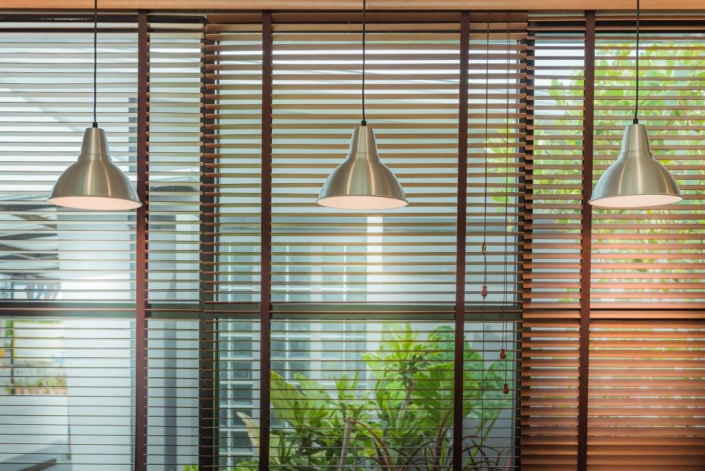 house with a window shade and lamp