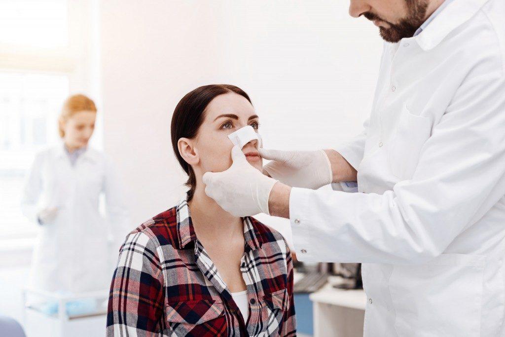 woman having a nose job