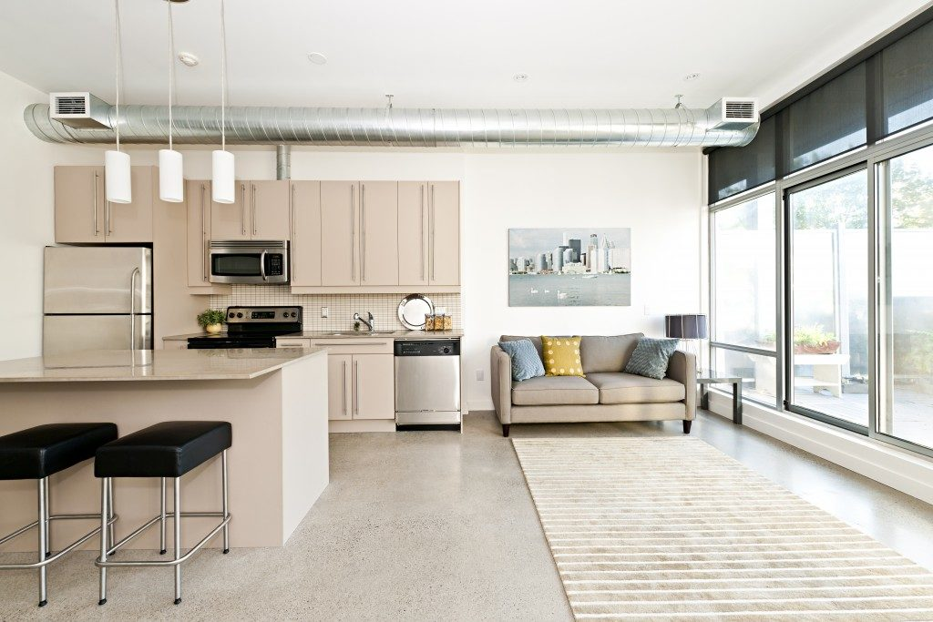 Kitchen and living room of loft apartment. Maximizing the use of space