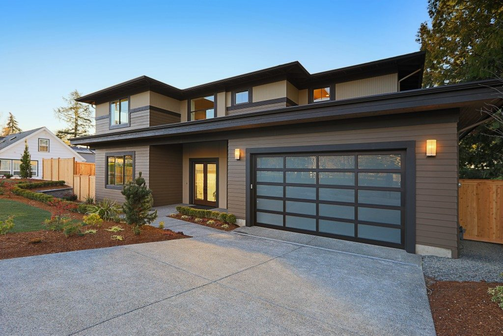 Modern house exterior with garden and concrete drive way