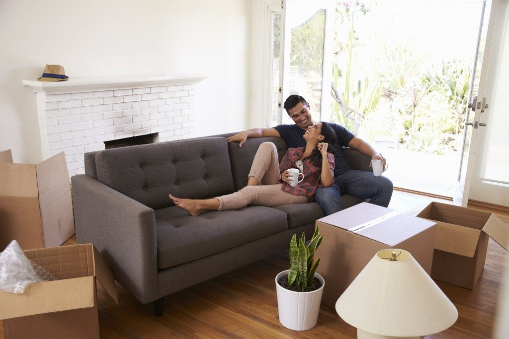 couple enjoying each others company in lounge chair