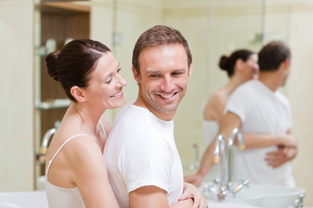 Couple sharing a bathroom