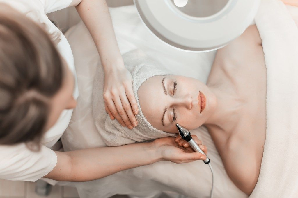 woman getting her facial treatment