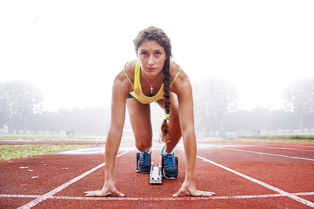 woman about to run track