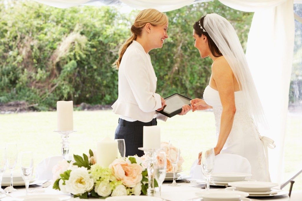 Bride With Wedding Planner In Marquee