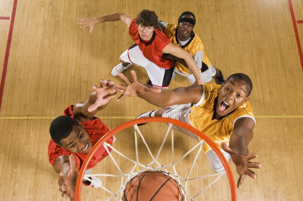 top view of students playing basketball