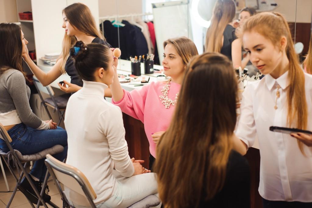 make up artists applying make up on women
