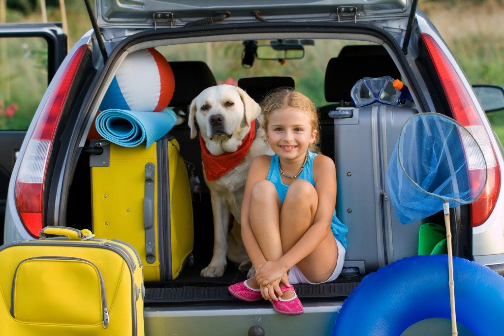 Family with dog ready to travel for summer vacation