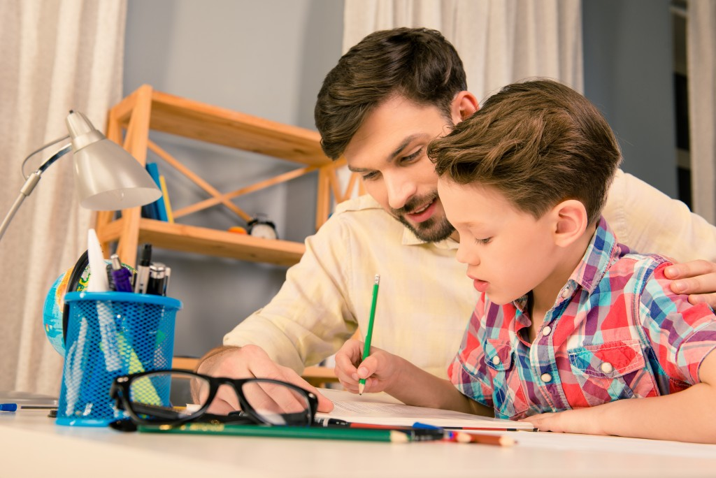 dad helping his son with homework