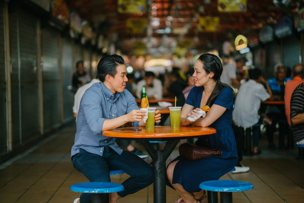 couple dining at an open area