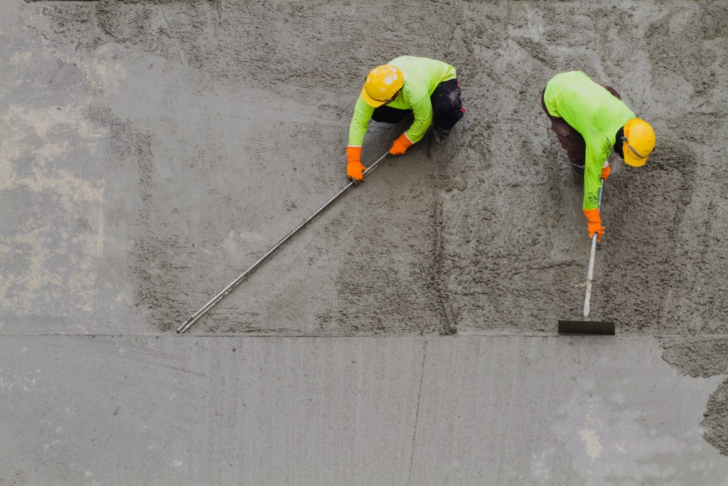 men paving concrete