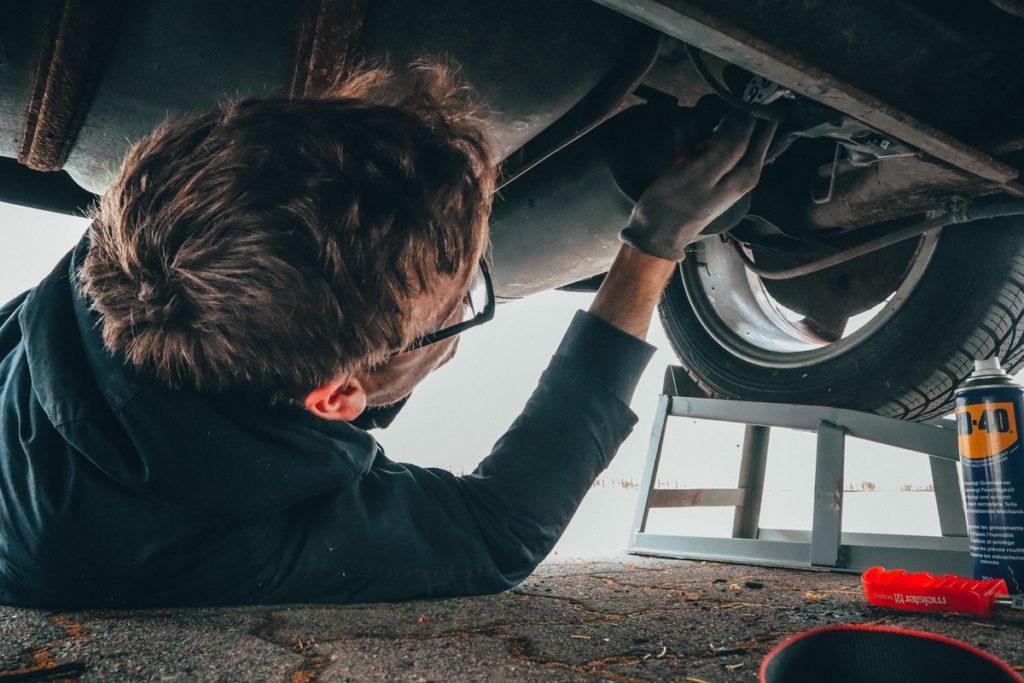 man-fixing-vehicle-engine
