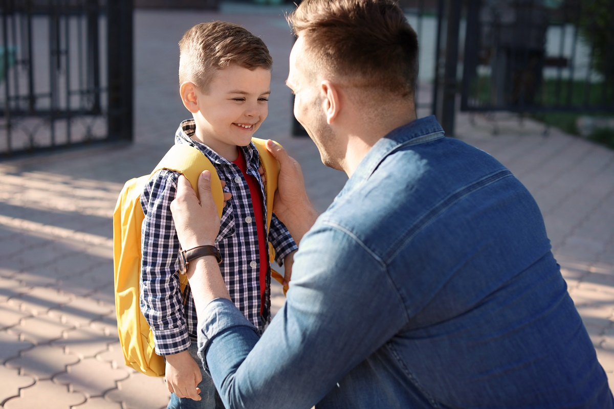 Father sending his son to school