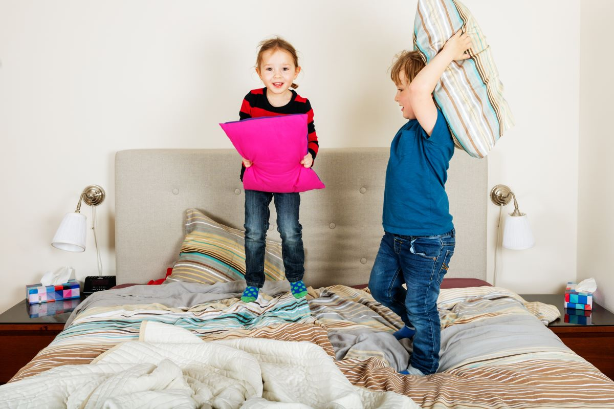 children playing on the bed