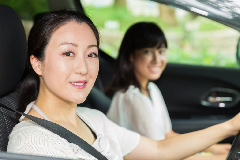 mother and daughter in car