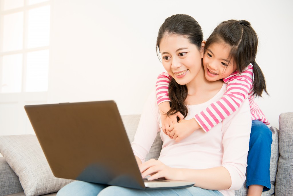 mom and child using the computer