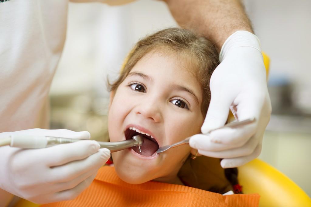 child having teeth checked