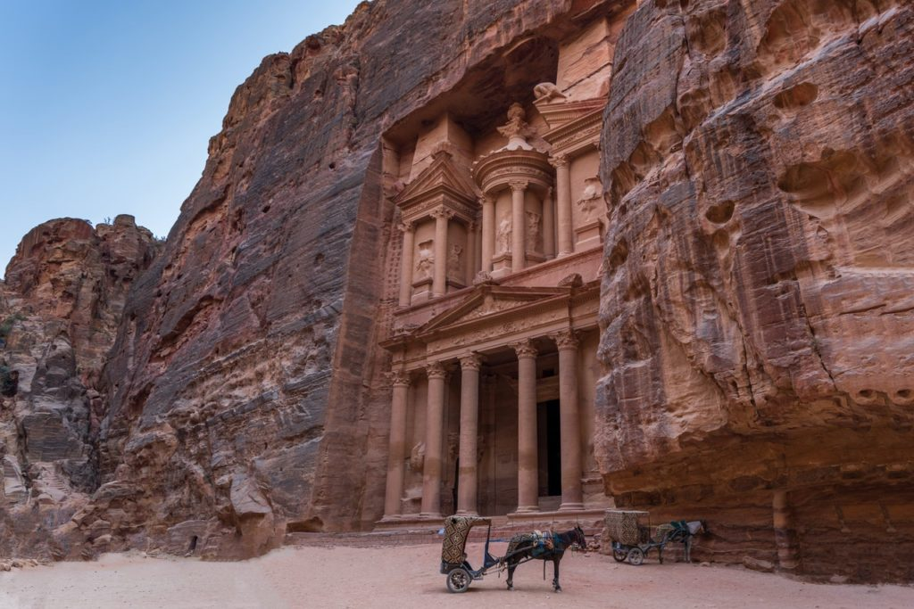 ancient building carved into the mountain side