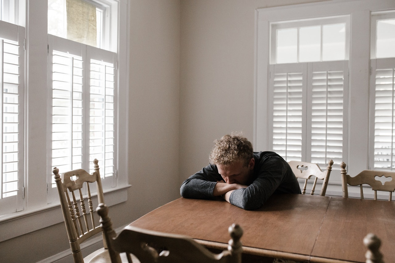 depressed man on a table