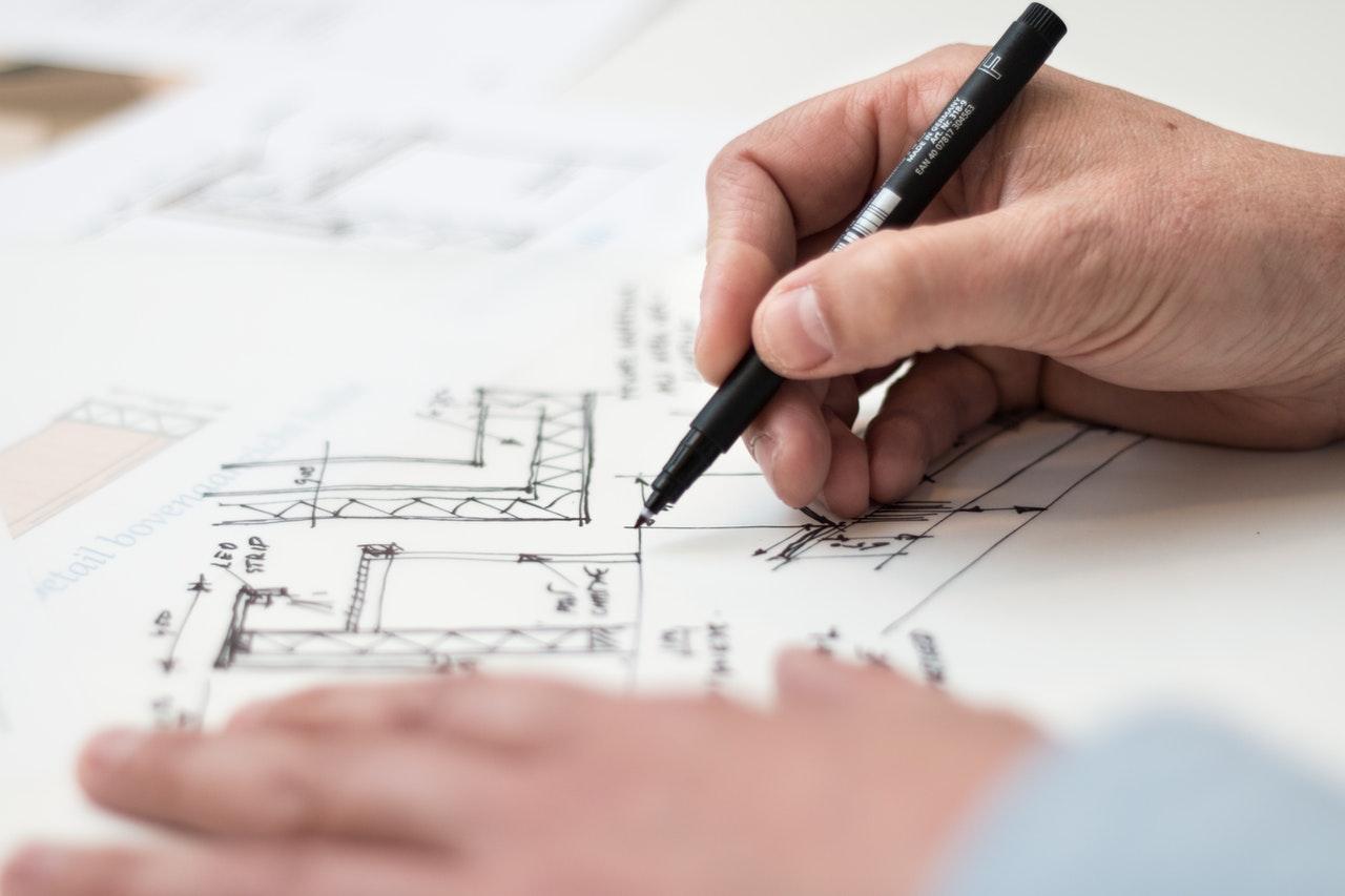 man drawing floor plan