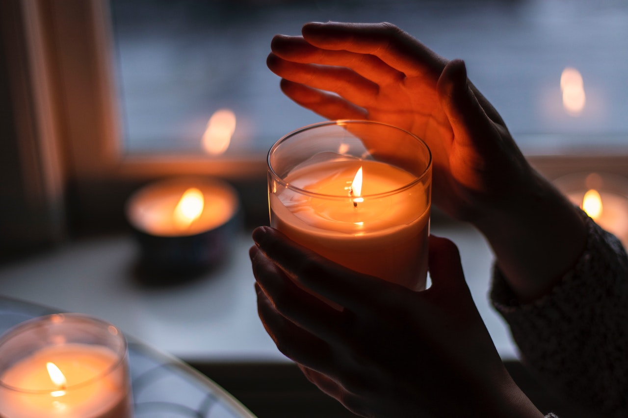 person holding a candle