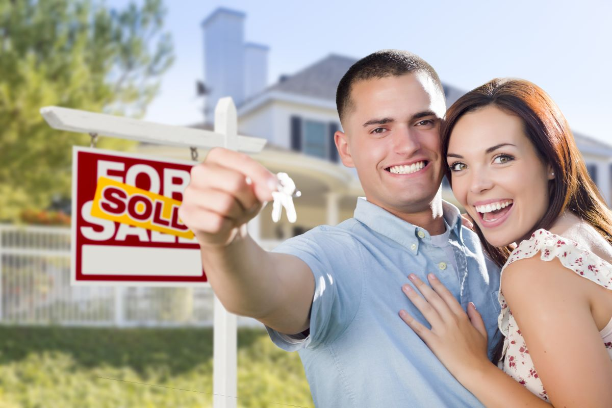 young couple buying house