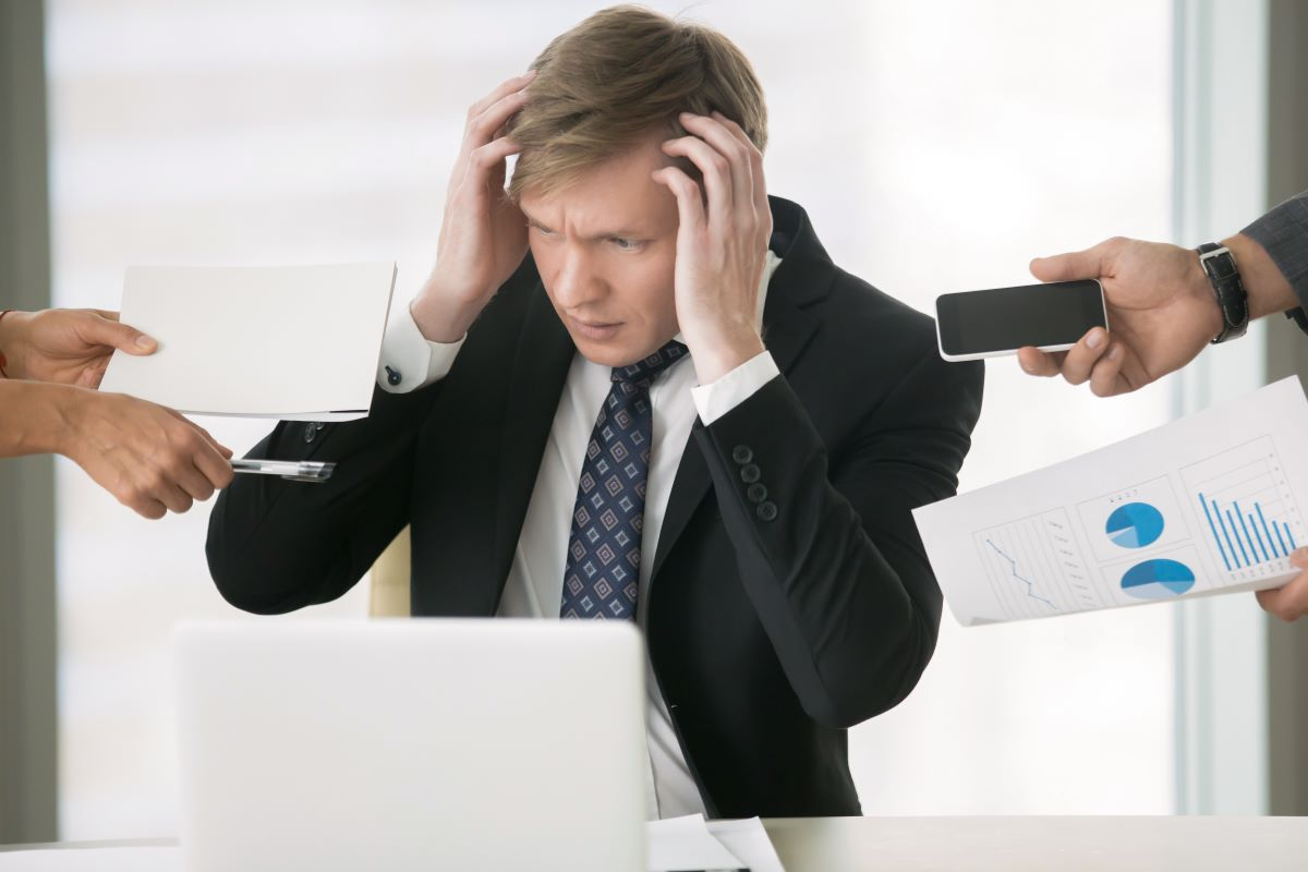 man overworked pressured
