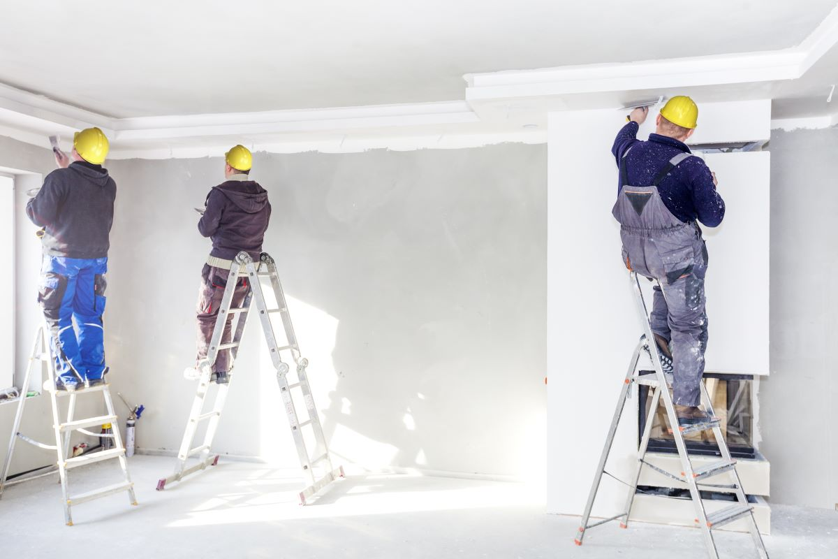 3 men painting room