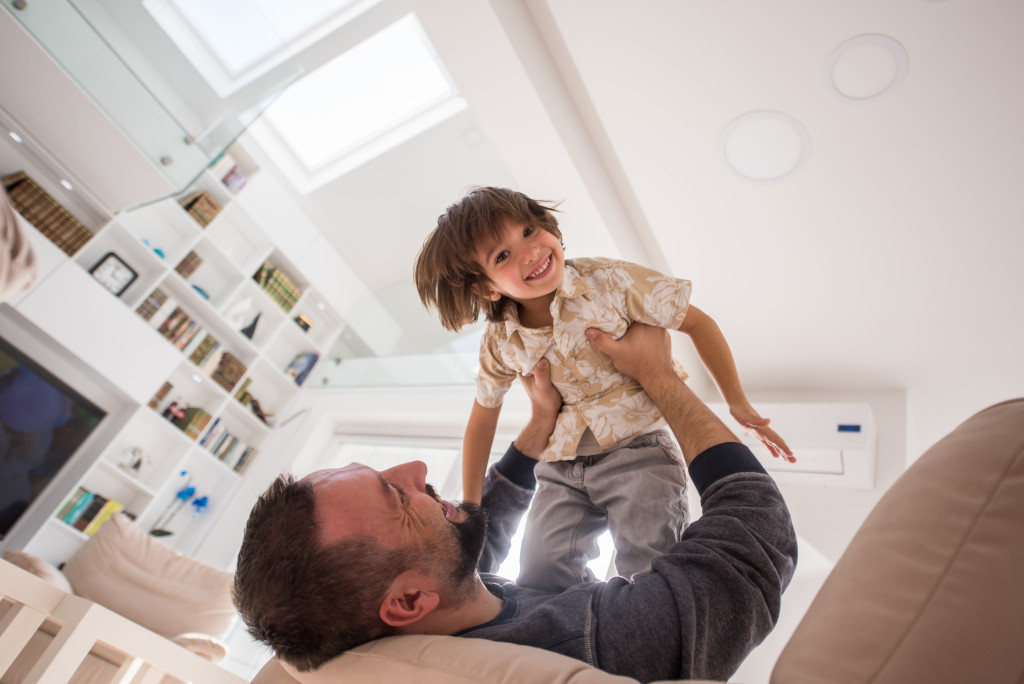 child and dad playing