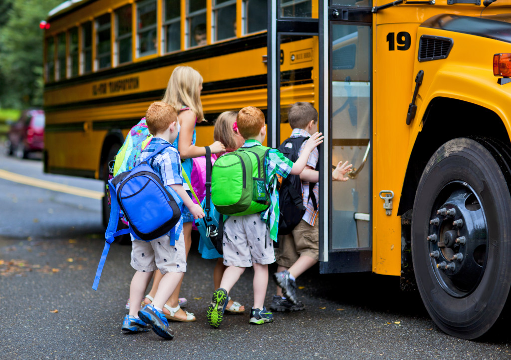 students getting on the school bus